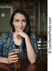 Beautiful Young Woman with Very Cute Smile and Beer