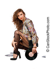 Beautiful young woman with vinyl disc