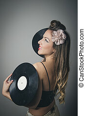 Beautiful young woman with vinyl records