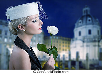 Beautiful young woman with white rose. Retro portrait