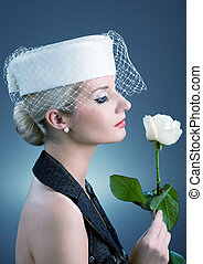 Beautiful young woman with white rose