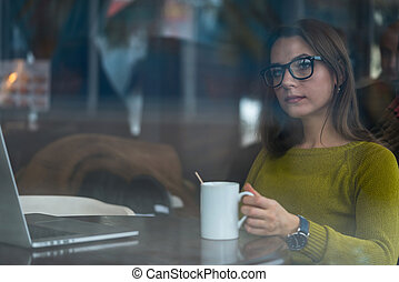 Beautiful young woman working in a cafe