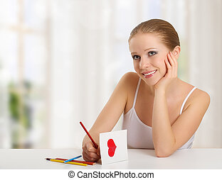 woman writes a love letter - a card for valentines day
