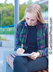 beautiful young woman writes