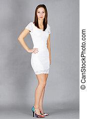 Beautiful young womanin white dress
