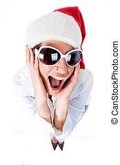 Beautiful young women embracing wearing santa\'s hat