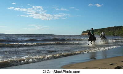 Beautiful young women horse riding at a beach