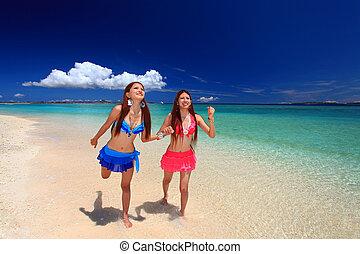Beautiful young women on the beach