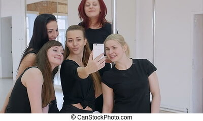 Beautiful young women taking a selfie during a break on a...