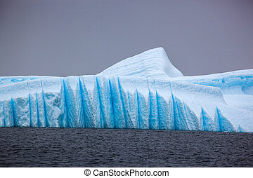 Beautifull big blue iceberg and ocean. Peculiar landscape of Antarctica