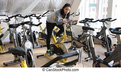 Beautifull female during cycling traning