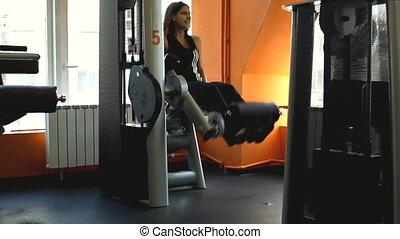 Beautifull female exercising their legs on the training