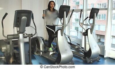 Beautifull female on an elliptical trainer