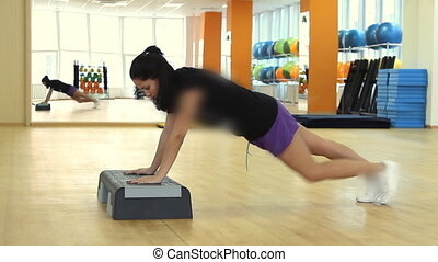 Beautifull female on the step board during exercise