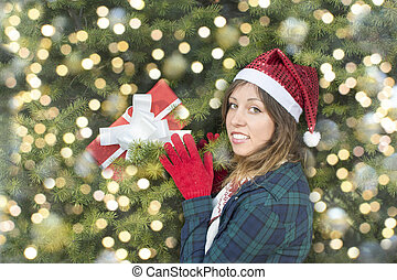 Beautifull girl with Santa Claus hat taking her present