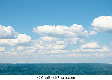 Beautifull soft blue sky with clouds over sea