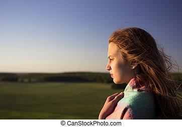 beautifull teenage girl looking into the distance