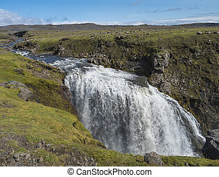 Beautifull waterfall on the Skoga River with no people on famous Fimmvorduhals trail second part of Laugavegur trek. Summer landscape on a sunny day. Amazing in nature. August 2019, South Iceland