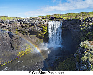 Beautifull waterfall on the Skoga River with rainbow and no people on famous Fimmvorduhals trail second part of Laugavegur trek. Summer landscape on a sunny day. Amazing in nature. August 2019, South Iceland