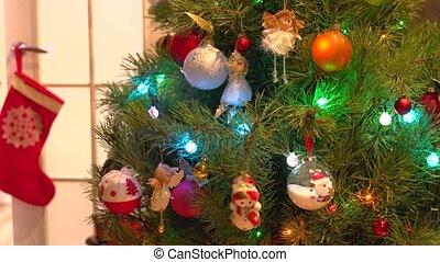 Beautifully decorated Christmas tree. Elegant shiny...