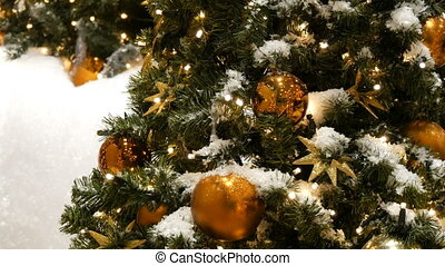 Beautifully decorated Christmas tree with large gold and...