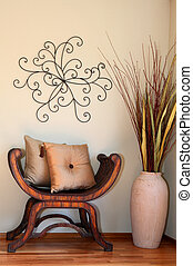 Great decorated corner with vase and dry branches, wood rustic chair, pillows and handmade abstract wall art