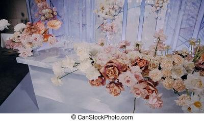 Beautifully decorated newlyweds presidium. Wide lens. Right...