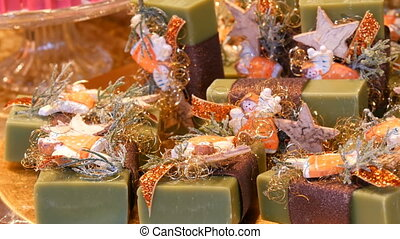 Beautifully packaged green assorted handmade soaps on the...