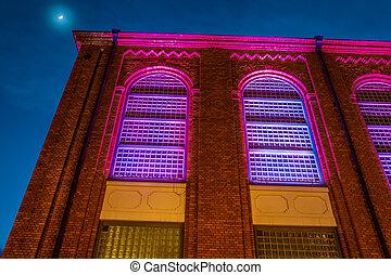 Beautifully renovated building illuminated at night