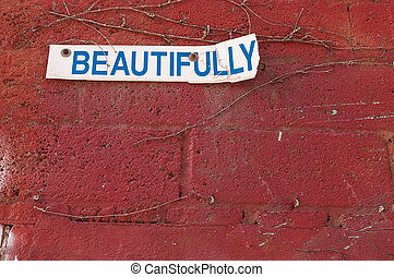 Beautifully sign on a red brick wall