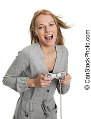 Beautilful young woman playing videogames. Isolated on white