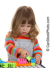 girl playing colorful building toy blocks - beauty a little...
