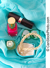 beauty accessories on blue scarf