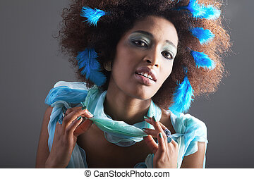 Beauty african woman with feather