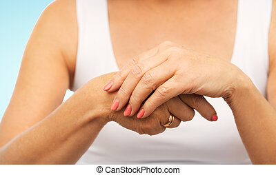 close up of senior woman hands with manicure