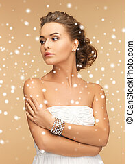 beautiful woman with pearl earrings and bracelet - beauty ...