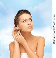 woman wearing shiny diamond earrings