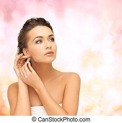 woman wearing shiny diamond earrings - beauty and jewelry ...
