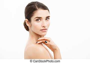 Beauty and Skin care concept - Close up Beautiful Young Woman touching her skin on white background.