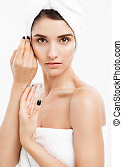 Beauty and Skin care concept - Close up Beautiful Young Woman touching her skin