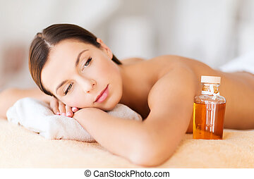 happy woman in spa salon - beauty and spa concept - happy...