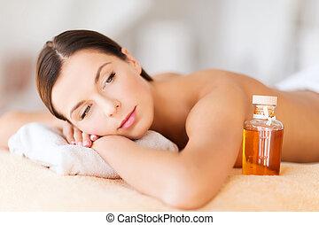 happy woman in spa salon - beauty and spa concept - happy...