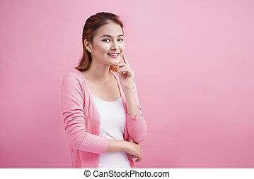 Beauty Asian Young Portrait. Beautiful Thinking Woman Touching her Face.