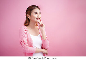Beauty Asian Young Portrait. Beautiful Thinking Woman Touching her Face.