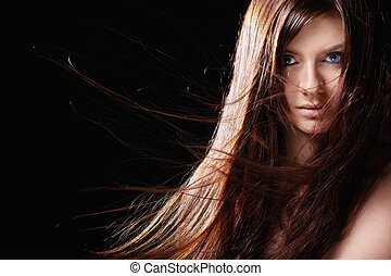 Beauty - Attractive girl with developing hair on a black ...