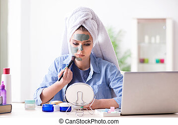 Beauty blogger applying mask and posting to internet blog