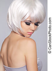 Beauty Blond Fashion Girl Model Portrait. Short Blond hair. Eye