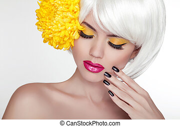 Beauty Blond Female Portrait with yellow flower. Beautiful Spa Woman Touching her Face. Makeup and manicured nails. Perfect Fresh Skin. Isolated on white background