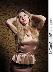 Beauty blond girl in beige dress