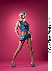 beauty blond girl stand on pink pin-up style